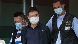 O jornalista Ryan Law no momento em que era detido pela polícia de Hong Kong