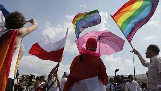 FILE: Participants dance as they march through Warsaw downtown during the Euro Pride gay parade in Warsaw, Poland, Saturday, July 17, 2010.
