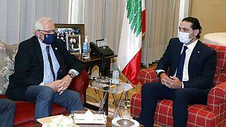 The EU's top diplomat Josep Borrell, right, meets with prime minister-designate Saad Hariri in Beirut on Saturday