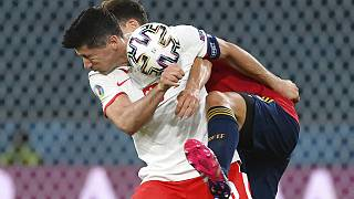 Poland's Robert Lewandowski and Spain's Pau Torres, behind, challenge for the ball during the Euro 2020 match on Saturday