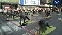 Times Square welcomes yogis back to celebrate the summer solstice