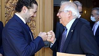 Lebanese Prime Minister-Designate Saad Hariri, left, greets European Union foreign policy chief Josep Borrell in Beirut on Saturday