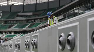 A worker cleans above air conditioning vents at Qatar Education Stadium, one of the 2022 World Cup stadiums, in Doha, Qatar.