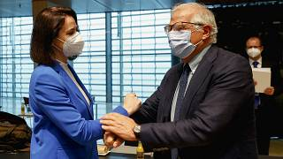 European Union foreign policy chief Josep Borrell, right, greets Belarusian opposition politician Sviatlana Tsikhanouskaya during a European Foreign Affairs Ministers meeting.