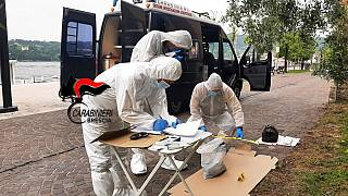 Italian forensic police on the scene at Lake Garda after the bodies of an Italian man and woman were found on Sunday