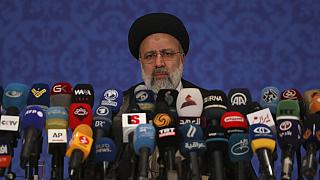 FILE: Iran's new President-elect Ebrahim Raisi speaks during a press conference in Tehran, Iran, Monday, June 21, 2021.