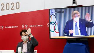 Tokyo 2020 President Seiko Hashimoto and IOC President Thomas Bach on screen, greet each other during a five-party meeting Monday, June 21, 2021