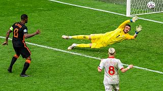 Georginio Wijnaldum of the Netherlands, left, scores his team's third goal during the Euro 2020 match between against North Macedonia in Amsterdam, Monday, June 21, 2021