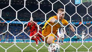 Belgium's Thomas Vermaelen, background, scores a goal as Finland's goalkeeper Lukas Hradecky fails to stop the ball in St. Petersburg, Russia, Monday, June 21, 2021