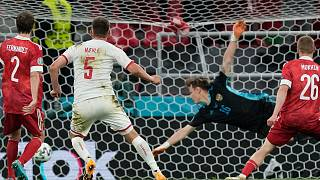 Denmark's Joakim Maehle, second left, scores his side's fourth goal during the match against Russia in Copenhagen, Monday, June 21, 2021