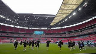 Czech players warm up during a team training session at Wembley stadium in London, June 22, 2021 .
