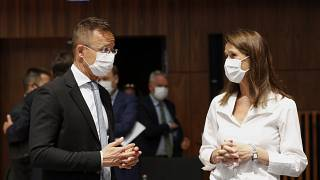 Belgium's Foreign Minister Sophie Wilmes talks to her Hungarian counterpart Peter Szijjarto.