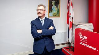 In this file photo taken on May 03, 2021 Democratic Unionist Party (DUP) MP Jeffrey Donaldson poses for a photo at the party's headquarters in Belfast.