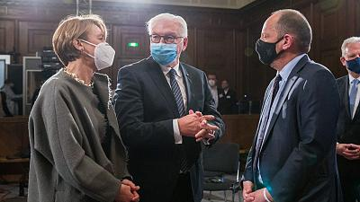 German President Frank-Walter Steinmeier (C) and his wife Elke Buedenbender talk with Philippe Sands, author, lawyer and international law expert