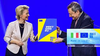 European Commission President, Ursula von der Leyen (L) symbolically hands to Italy's Prime Minister, Mario Draghi the NextGenerationEU recovery plan, on June 22, 2021 in Rome