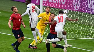 England's Raheem Sterling (R) scores the only goal during the UEFA EURO 2020 Group D match between Czech Republic and England at Wembley Stadium in London on June 22, 2021.