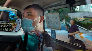 Tong Ying-kit arrives at a court in a police van in Hong Kong, on July 6, 2020.