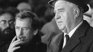 In this Nov. 26, 1989 file photo the last Czechoslovak communist prime minister Ladislav Adamec, right, attends a demonstration during the so-called Velvet Revolution