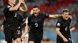 Germany's Leon Goretzka, left, celebrates with teammates after scoring his side's second goal