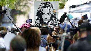 A portrait of Britney Spears looms over supporters and media members outside a court hearing over the singer's conservatorship in Los Angeles on July 23, 2021.