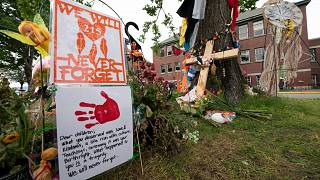 Signs are pictured at a memorial outside the Residential School in Kamloops, British Columbia., June, 13, 2021.
