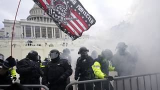 In this Jan. 6, 2021 picture, U.S. Capitol Police officers hold off rioters loyal to President Donald Trump at the Capitol in Washington.
