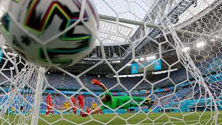Poland's goalkeeper Wojciech Szczesny fails to make a save during their Euro 2020 match against Sweden in St Petersburg, Russia, on June 23, 2021.