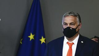 Hungary's Prime Minister Viktor Orban leaves at the end of the first day of an EU summit at the European Council