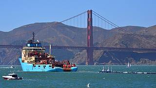 FILE: A ship tows The Ocean Cleanup's first buoyant trash-collecting device toward the Golden Gate Bridge en route to the Pacific Ocean (2018)