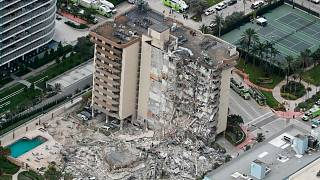 This aerial photo shows part of the 12-story oceanfront Champlain Towers South Condo that collapsed early Thursday, June 24, 2021 in Surfside, Florida.
