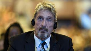 Software entrepreneur John McAfee listens during the 4th China Internet Security Conference (ISC) in Beijing in this file photo from Tuesday, Aug. 16, 2016