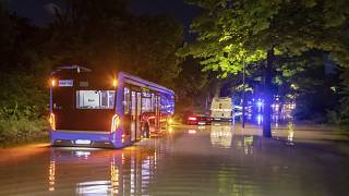A bus is pictured stuck in water on a flooded road in Munich on Wednesday night.