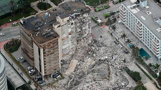 This aerial photo shows part of the 12-story oceanfront Champlain Towers South Condo that collapsed early Thursday, June 24, 2021 in Surfside, Florida, U.S.