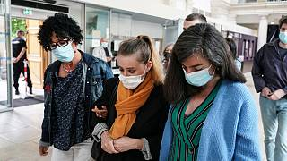 Valerie Bacot, centre, arrives with relatives at the Chalon-sur-Saone courthouse, central France, Thursday, June 24, 2021.