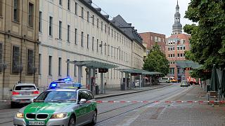 Police cars attend the scene of knife attack in Wuerzburg, Germany, Friday June 25, 2021