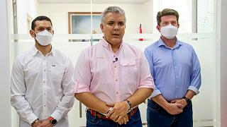 President Ivan Duque speaks, flanked by Interior Minster Daniel Palacios, left, and Defence Minister Diego Molano, in Cucuta, Colombia, Friday, June 25, 2021.