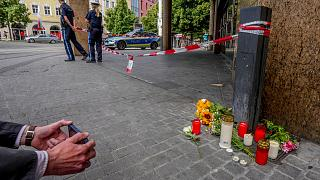 Flowers and candles were laid at the crime scene in central Wuerzburg, Germany, Saturday, June 26, 2021.