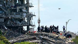 Rescue workers search in the rubble for survivors at the Champlain Towers South condominium, Saturday, June 26, 2021, in the Surfside area of Miami.