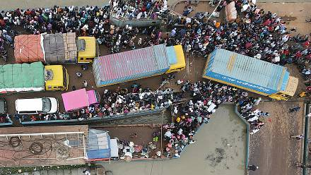Migrant workers flee capital as Bangladesh tightens Covid lockdown