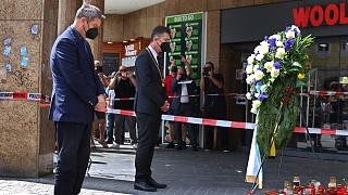 Bavaria's governor Markus Soeder, left, and the mayor of Würzburg, Christian Schuchardt, attend a memorial service in Würzburg, Germany, Sunday, June 27, 2021.