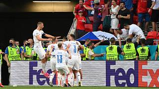 Czech Republic players celebrate after Czech Republic's Tomas Holes scored his side's opening goal.