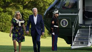 President Joe Biden and first lady Jill Biden walk on the South Lawn of the White House after stepping off Marine One, Sunday, June 27, 2021, in Washington.