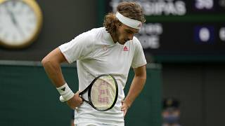 Stefanos Tsitsipas of Greece loses a point to Frances Tiafoe of the US during the men's singles match on day one of the Wimbledon Tennis Championships in London