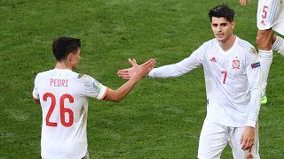 Spain's Alvaro Morata celebrates with his teammate Pedri