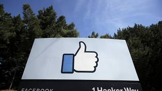 In this April 14, 2020 file photo, the thumbs up Like logo is shown on a sign at Facebook headquarters in Menlo Park, California.