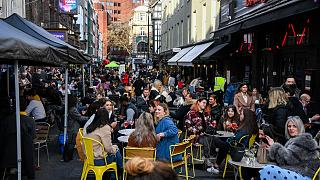 Outside cafes and pubs in Soho, central London, on the day some of England's coronavirus lockdown restrictions were eased by the British government, April 12, 2021.