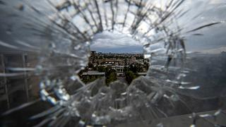The city of Mekele is seen through a bullet hole in a stairway window of the Ayder Referral Hospital, in the Tigray region of northern Ethiopia, May 6, 2021.