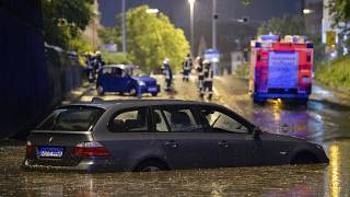 A car stands in the flooded car underpass in Stuttgart, Germany, Monday, June 28, 2021.