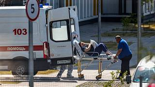 Medical workers carry a patient suspected of having coronavirus on a stretcher at a hospital in Kommunarka, outside Moscow, Russia, June 26, 2021.