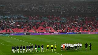 Players stand for national anthems during the Euro 2020 match between England and Scotland, at Wembley Stadium, in London, Friday, June 18, 2021.